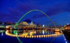 Gateshead Millenium Bridge, Newcastle, England -- a pedestrian bridge that lifts up and rotates like a winking eye to allow boats to pass under The World's Most Beautiful Bridges