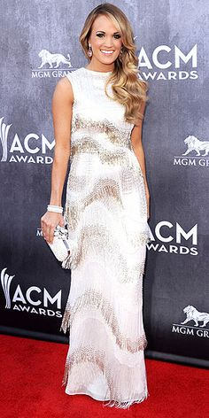 Country Goes Couture: The Looks of the ACMs | CARRIE UNDERWOOD | Do they hand out statues for Best Hair at the Academy of Country Music Awards? If so, we're putting our money on Carrie, whose waves are just as show-stopping as her white-and-metallic allover-beaded fringe dress.