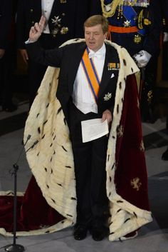 King Willem-Alexander of the Netherlands takes the oath during his inauguration ceremony on 30 April 2013 at NieuweKerk (New Church) in Amsterdam