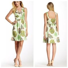 """BNWT Eva Franco Perfect Spring Dress SIZE 8 - APPROX. MEASUREMENTS LAYING FLAT - 17"""" W ACROSS CHEST - 38"""" L SHOULDER TO HEMLINE  100% COTTON - FULLY LINED - FLORAL PRINT IN VARIOUS SHADES OF GREEN CALLED LILY PAD - OFF WHITE BACK ROUND  SURPLICE NECKLINE WITH ROUNDED COLLAR - BANDED TIE-BACK AT WAIST - PLEATED SKIRTING - ON SEAM POCKETS - SIDE ZIP  BRAND NEW WITH TAG Eva Franco Dresses Midi"""