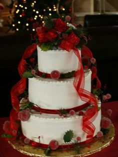 Gorgeous cake for a Christmas wedding, but use plastic holly berries or make them edible out of sugar, because, like poinsettias and mistletoe, holly berries are toxic.