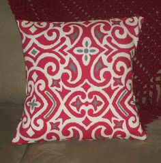 This beautiful decorative pillow cover is in a bright fuschia, grey and white geometric design. It is available in 18 x 18 inches and the