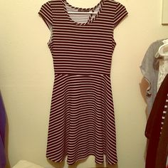 "Little black dress Worn once; adorable white and black stripped dress with short sleeves; a little over the knees but if worn with heels/wedges, it'll be short. Back side has a ""V"" opening. a'gaci Dresses Mini"