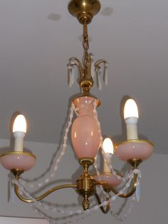 I found this French pink opalescent chandelier for one of the guest bedrooms, love it!