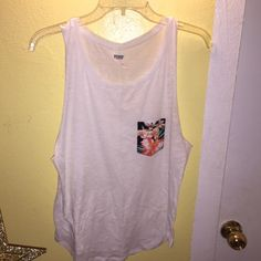 Muscle tee from PINK. Worn once. Size S but fits me and I'm a size L. It depends on how you want the shirt to look on you. PINK Victoria's Secret Tops Muscle Tees