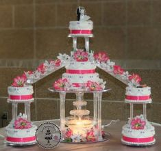 traditional quinceanerea cake   This all white, tiered wedding cake featured a water fountain and ...