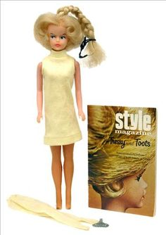 "Had a ""Tressy"" doll...her hair ""grew"" out of the top of her head when the key was used in her back."