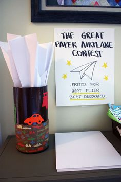 Paper airplane contest with prizes for best flier and best decorated