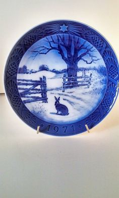"""Blue and white Christmas collector's plate made by Royal Copenhagen. The plate is dated 1971. It measures 7 1/8 inches in diameter no chips or cracks.   The back is marked """"Royal Copenhagen Denmark"""" and has holes for a wire to hang the plate on the wall. This would display beautifully and would make a great addition to your collection"""