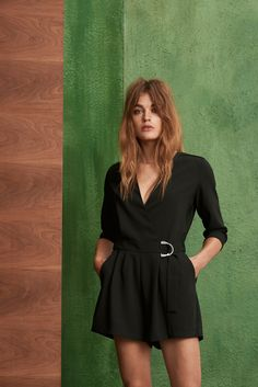 fe125dfab12 Sexy and chic playsuit by Danish designer MbyM. Features a cool low back  detail and a belt fastening. Available in store an on Trouva.
