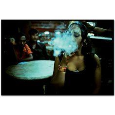 Transvestite smoking in the Olympia Cafe.Falkland Road, Bombay, India. 1978  by Mary Ellen Mark