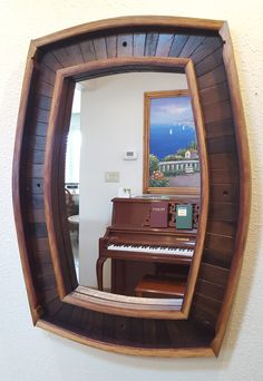 Mirror frame made from wine barrels.This is an original piece and can also be customized by Old Path Woodcraft