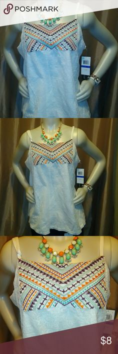 Ladies XL White Spaghetti Strap Tank The shirt has a lace overlay and peek-a-boo top with a geometrical print design with hues of turquoise, brown, orange and green. This My Michelle top is a stretchy mix of Polyester. This new with tags XL white tank is a perfect match for jeans on a summer day or put it under a blazer or jean jacket on a fall or winter day. Match this shirt with a pair of chocolate boots or a pair of white wedges and you have the perfect outfit for any season. Don't pass…