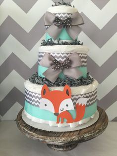 Fox Diaper Cake in Mint, Grey and White, Woodland Baby Shower Centerpiece by AllDiaperCakes on Etsy https://www.etsy.com/listing/269902607/fox-diaper-cake-in-mint-grey-and-white