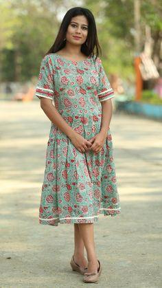 07a0e83dd418 Floral print ocean green pleated dress