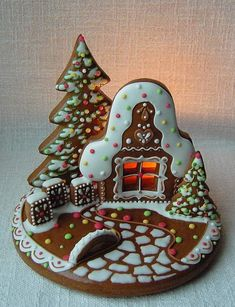 amazing gingerbread house cookie!  (I know I will never make this but I have to pin it because I haven't ever seen anything like it and it's so cute!)