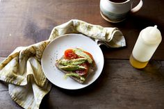 whole wheat toast with hummus, avocado, tomatoes, olive oil, salt + pepper. coffee.