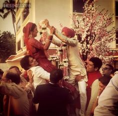 Drashti Dhami and Neeraj Khemka being lifted in the air during their varmala ceremony.