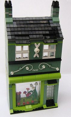 Green house with gorgeous decorative elements.