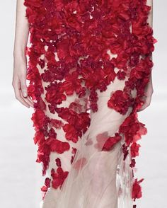 red petals flowing down the dress