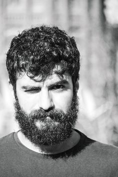 Men's Wavy Hair and Beard.