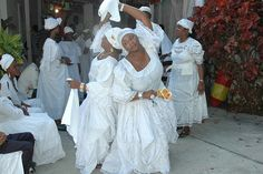 Woman salutes her mother in a Vodou ceremony, Haiti Voodoo Hoodoo, Voodoo Spells, Voodoo Priestess, Spiritual Religion, Almighty Allah, Film Inspiration, To My Mother, Orisha, African Diaspora