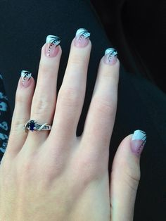 Acrylic French tips with black and white designs.