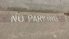 Faded no parking on concrete