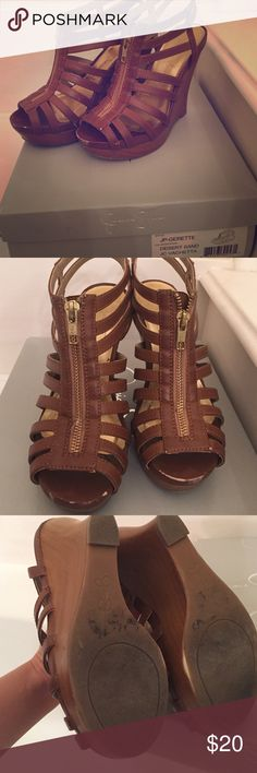 Jessica Simpson caged wedge Worn but still good. Nice tanned neutral color. Perfect wedge comfort. Jessica Simpson Shoes Wedges