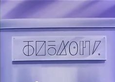 "it says ""Kakaroto"" in the Alien language spoken in planet Vegeta...  It was written in the incubator where baby Goku was  before has been sent to the earth."