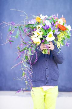 purple lilac vine, water lily, poppy, clematis, maindenhair fern, vibernum, sweet pea, tulip and acacia bouquet by Tulipina