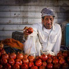The Pomegranate Salesman In Najaf Bazaar Of Iraq