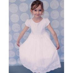 Vintage style communion dress with a scalloped hem and eyelet lace. 1st Holy Communion Style