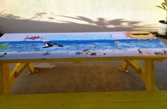 Customized beach picnic table ready for beachy fun.  Only problem is I can't stop adding to it.  Banner is chalkboard paint so the message can be changed or seasonal.