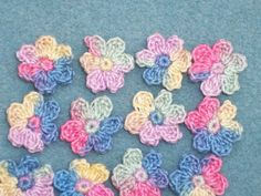 16 handmade variegated crochet applique flowers -- 34
