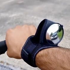 Wrist mounted wing mirror for cycling