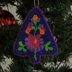 Embroidered felt ornament from fabact.co.  Lots of ornaments on this site.