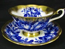 ROYAL ALBERT TREASURE CHEST BLUE ROSES GOLD TEA CUP AND SAUCER