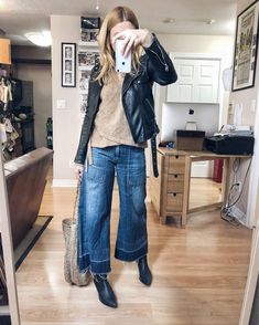 What I wore. I am wearing wide leg cropped jeans, a brown sweater, a moto jacket, and black booties with a large woven tote bag. Cropped Jeans Outfit, Jeans Outfit Winter, Fall Jeans, Fall Winter Outfits, Ankle Boots Outfit Winter, Crop Jeans, Jeans Pants, Shirt Outfit, Skinny Jeans