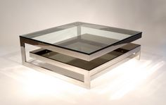 Contemporary square chrome and glass coffee table.
