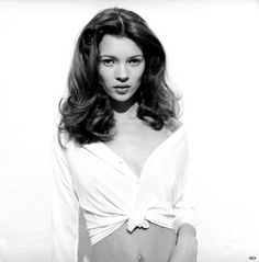 Kate Moss, tie-shirt and big curls 1992. http://www.dazeddigital.com/fashion/article/18032/1/top-10-early-kate-moss-moments