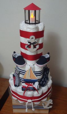 Nautical lighthouse diaper cake. With a real working tea light! Ideal for nautical, sailboat or boat themed baby showers!