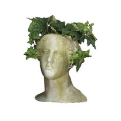 Head Planter Pot  This Venus bust planter is made of fiber stone, which has the appearance of aged stone. Fiber stone is made of sand and high quality stone particulate that is casted into the surface of the resin mold and finally is reinforced with a fiberglass backing.