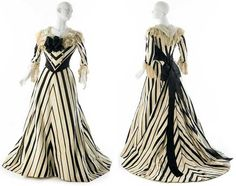 Afternoon dress, Worth, ca. 1900. Cream ribbed silk with black satin stripes, lengths joined to create chevron stripes; white silk chiffon; black satin; cream net lace; white tulle. Trumpet-shaped skirt, flat in front. Bodice front folds down at the neck edge, in semblance of a collar, and is finished with a black satin bow. Museum of the City  of New York