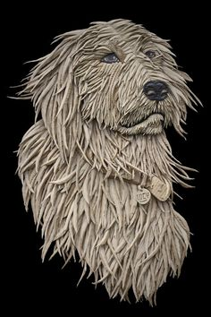 This this portrait of a dog by artist Ali Golzad, made of nothing but recycled cardboard, is amazingly expressive.