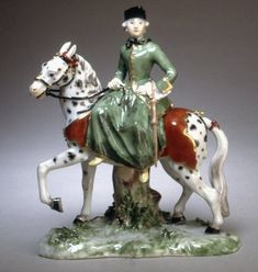 Figure of lady rider; dappled horse with orange saddle-cloth, left forefoot raised, supported by stump; rider in green habit with flowered skirt trimmed with gold, wears black hat and sits side-saddle to left; Cold Porcelain Jewelry, China Porcelain, Chinese Antiques, British Museum, Vintage Art, Gallery, Artist, Side Saddle, Riding Habit