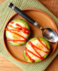 Eggs baked in an avocado! like to top mine with a drizzle of sriracha hot sauce!