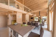 Lumi Polar Introduces new homes in France: Chalet de charme and Chalet bien-être for the suburban complex «Les 4 Saisons Pine Timber, House In The Woods, Log Homes, Antalya, Modern, Relax, Istanbul, Table, Interior