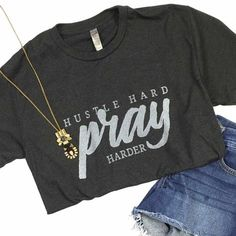 """On a heather charcoal with """"Hustle Hard Pray Harder"""" design. FIT: Unisex - True to size. Size Bust/Chest Inches XS 30-32 Small 34-36 Medium 38-40 Large 42-44 XL 46-48"""