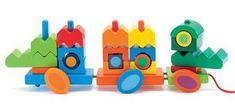 Talrijke montage/ en stapelmogelijkheden om een heleboel krokodillen, die voortgetrokken kunnen worden, en in elkaar worden gezet. 23 speelgoedelementen van gekleurd hout. - Djeco Creacroco